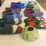 A range of felted slippers and a bowl