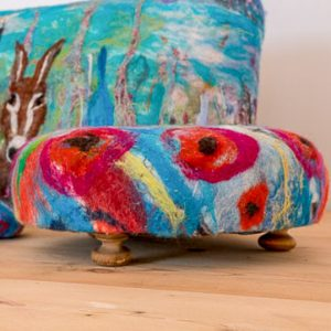 A beautiful footstool upholstered in a unique felt design